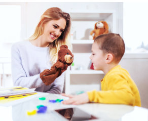 woman and little boy smiling
