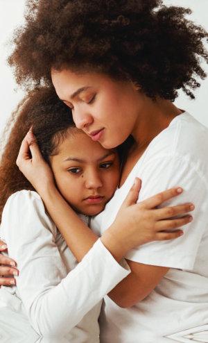little girl hugging her mommy